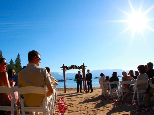 Wedding ceremony on the beach at Roundhill Pines