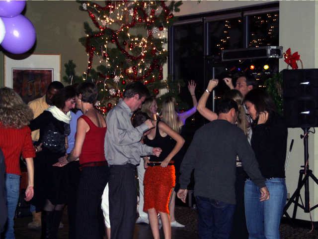 Guests dancing at a Christmas party