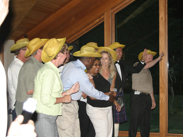 "Guests wearing yellow ""Team"" hats at corporate event"
