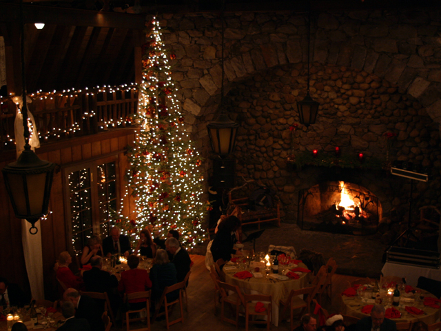 Christmas tree inside Valhalla Grand Hall with guests at party