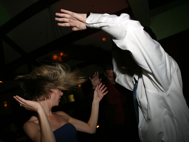 Two guests dancing at a Christmas party