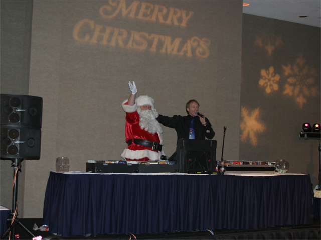 DJ introducing Father Christmas at a Christmas party