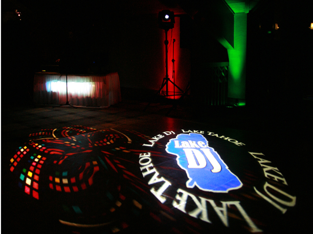 LakeDJ monogram projected onto the floor at an event