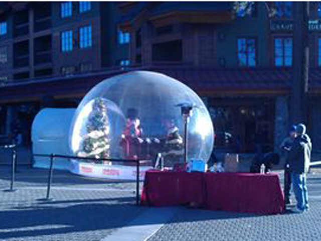 Santa's workshop inside a 16-foot snow globe