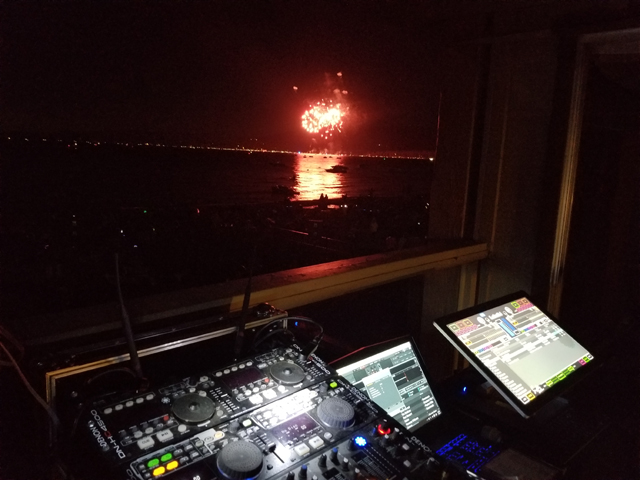 DJ Setup with Fireworks in the Background