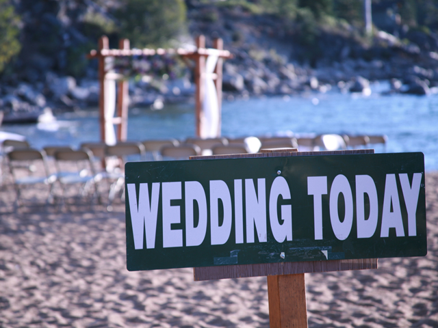 Wedding sign on the beach at Roundhill Pines